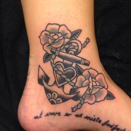 flowers and anchor tattoo on ankle
